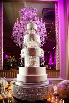 Five layer cake with orchid and crystal details on custom stand