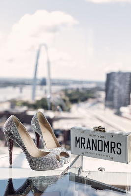 Christian Louboutin peep toe sparkle heels with New York Mr and Mrs license plate clutch St. Louis