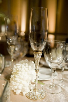 Champagne glass with white, gold, and crystal details