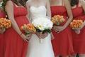 Orange tulip bridesmaid flowers and white bridal bouquet