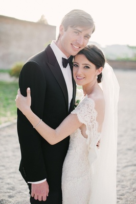 bride in lace dress with groom in italy
