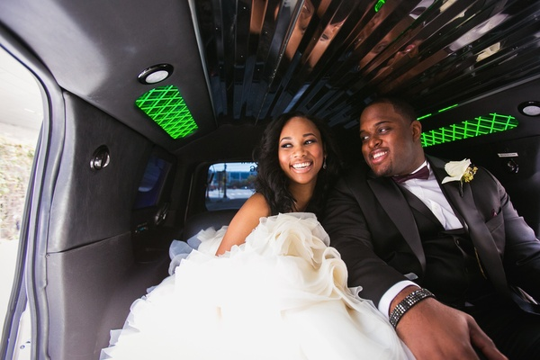 NFL player Brandon Mebane in limo with bride