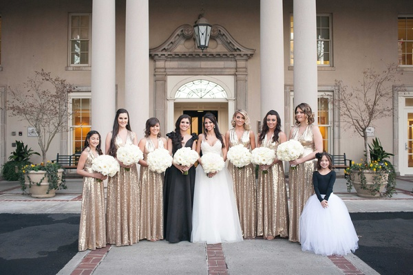 Bridesmaids wearing long gold sequin bridesmaid dresses