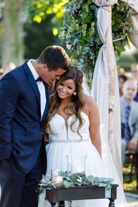 bride in strapless wedding dress crystal belt sash groom in navy blue suit with marsala bow tie
