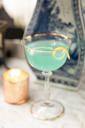wedding signature cocktail, turquoise cocktail with lemon peel
