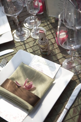 Pink and green tabletop design on textured linens