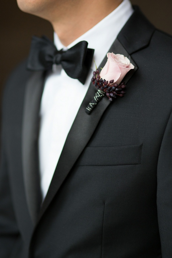 Black suit pink tie wedding