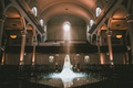 bride in wedding dress and long veil in ceremony space vibiana light streaming through window