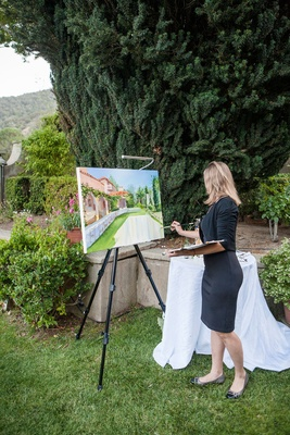 an artist doing a painting of the couples outdoor reception space at estate in northern california