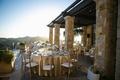 malibu rocky oaks wedding reception overlooking Santa Monica Mountains, gold chairs