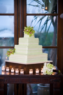 Four layer cake with white and lime green frosting