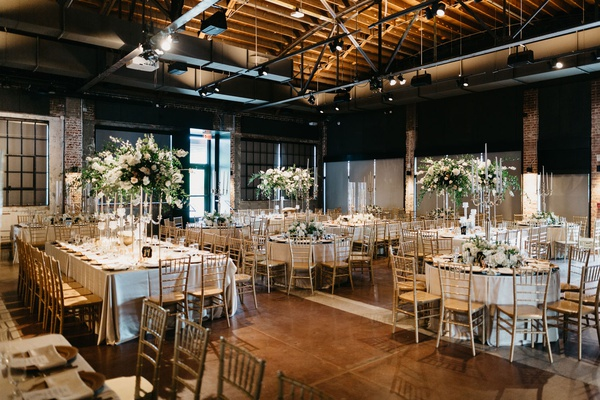 former miss america savvy shields wedding reception venue tall centerpiece gold chairs beams