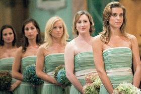Bridesmaids in celadon gowns at ceremony