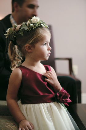 Flower girl with green and white flower crown and burgundy dress