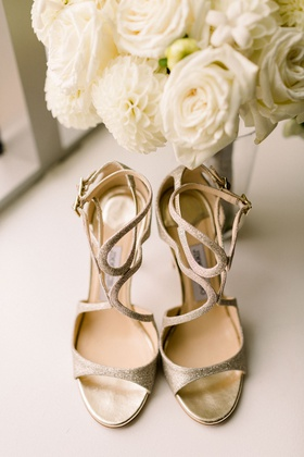 gold jimmy choo wedding shoes with strappy details and glitter