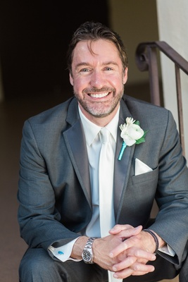 IDW Publishing founder Ted Adams in a grey suit, white tie, boutonniere on his wedding day