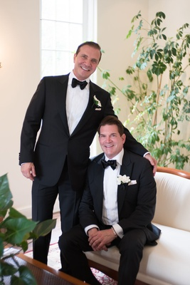Groom and groom in tuxedos with bow ties and ivory boutonnieres san diego wedding gay wedding