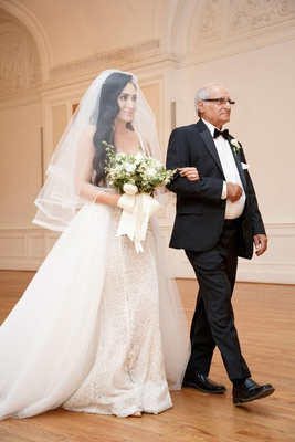 wedding ceremony processional bride with father arm in arm overskirt sparkle gown veil long hair