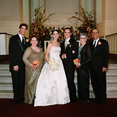Bride and groom at ceremony altar with parents