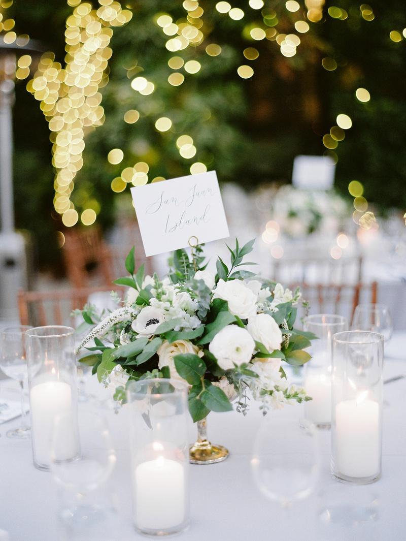 wedding reception centerpiece with ranunculus, anemone, eucalyptus