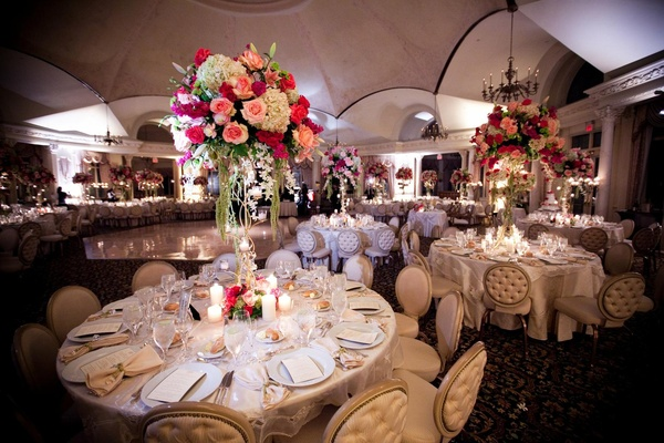 Round back reception chairs with tufting at ballroom wedding