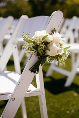 white roses, aisle markers, ceremony chairs