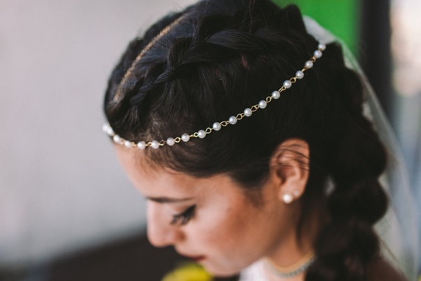 pearl and gold headpiece crown of head, braided hairstyle