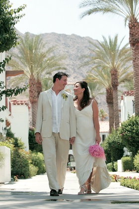 Mary Dann and groom walking through resort