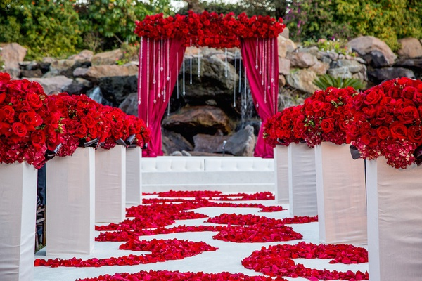 Indian wedding with vibrant colors and gorgeous red roses for Red decoration for wedding