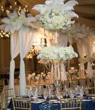 round table navy linen pattern feather arrangement north carolina wedding flowers crystals gold