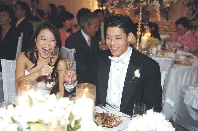 Reception Décor Photos - Bride and Groom Toast - Inside Weddings