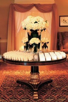 Escort cards displayed on country club round table
