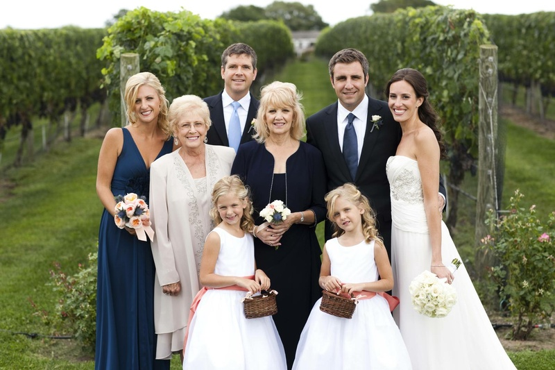 Newlyweds at vineyard with mother-of-the-groom