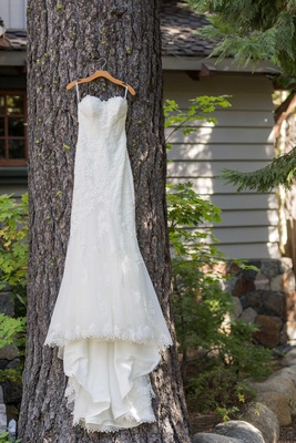 mermaid gown on woodland tree hung up lace details sweetheart neckline