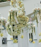Chandelier covered in flowers and crystals