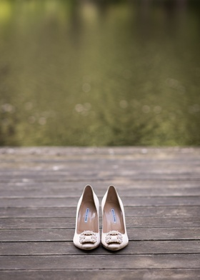 manolo blahnik champagne bridal heels with square brooch at the toe
