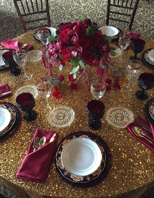 Designs by Tricia Marsala wedding flowers on gold sequin table