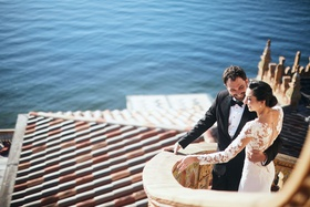 bride in pronovias gown with lace bodice, crepe skirt, groom in tuxedo, ca' d'van wedding ocean view