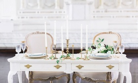 Vintage sweetheart table & chairs, brass candlesticks at Vibiana