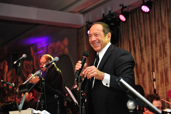 Singer Paul Anka performing at wedding reception