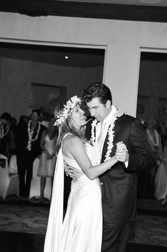 Black and white photo of Hawaiian lei wedding couple