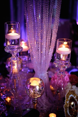 wedding reception glam luxe decor crystal details floating candles glass candlesticks gold votives