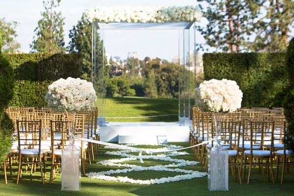 Wedding ceremony grass lawn country club gold chairs white flower petal aisle runner lucite acrylic