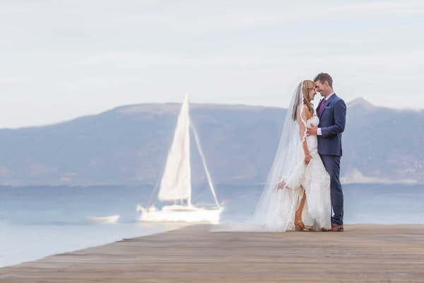 bride groom pose dock lake tahoe sailboat long veil blue suit purple tie