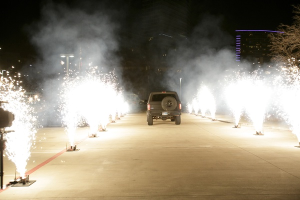 newlyweds ride off in truck through road lined with fireworks