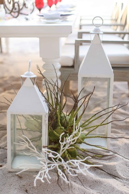 white lanterns sea plant coral beach mexico punta mita styled shoot destination wedding decor