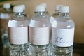 I do Jenna + Kelly and initial labels with wedding date for wedding favor water bottles