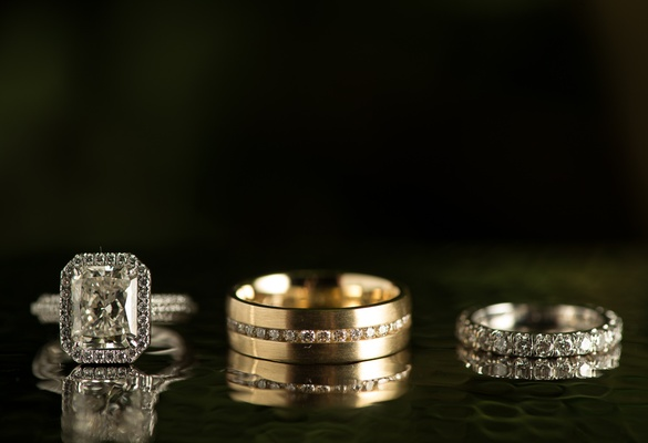 Gold men's band with diamonds and bride's rings