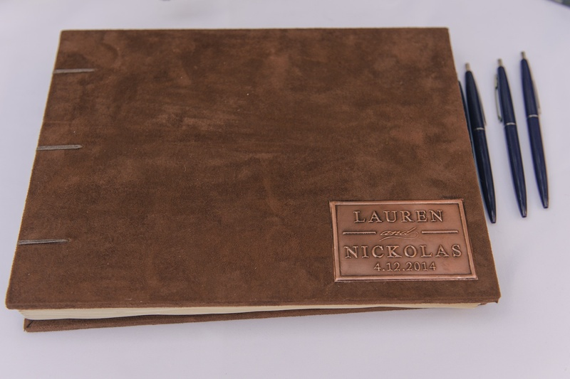 Suede guestbook with bronze plaque and celebrity names