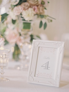 Wedding reception table number in a ceramic white frame